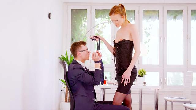 Classy redhead acts dominant with the man in a seductive cam play