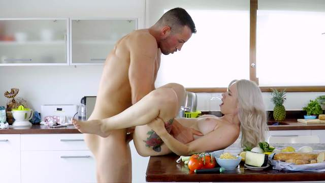 Deep penetration on the kitchen table before a perfect cumshot on tits
